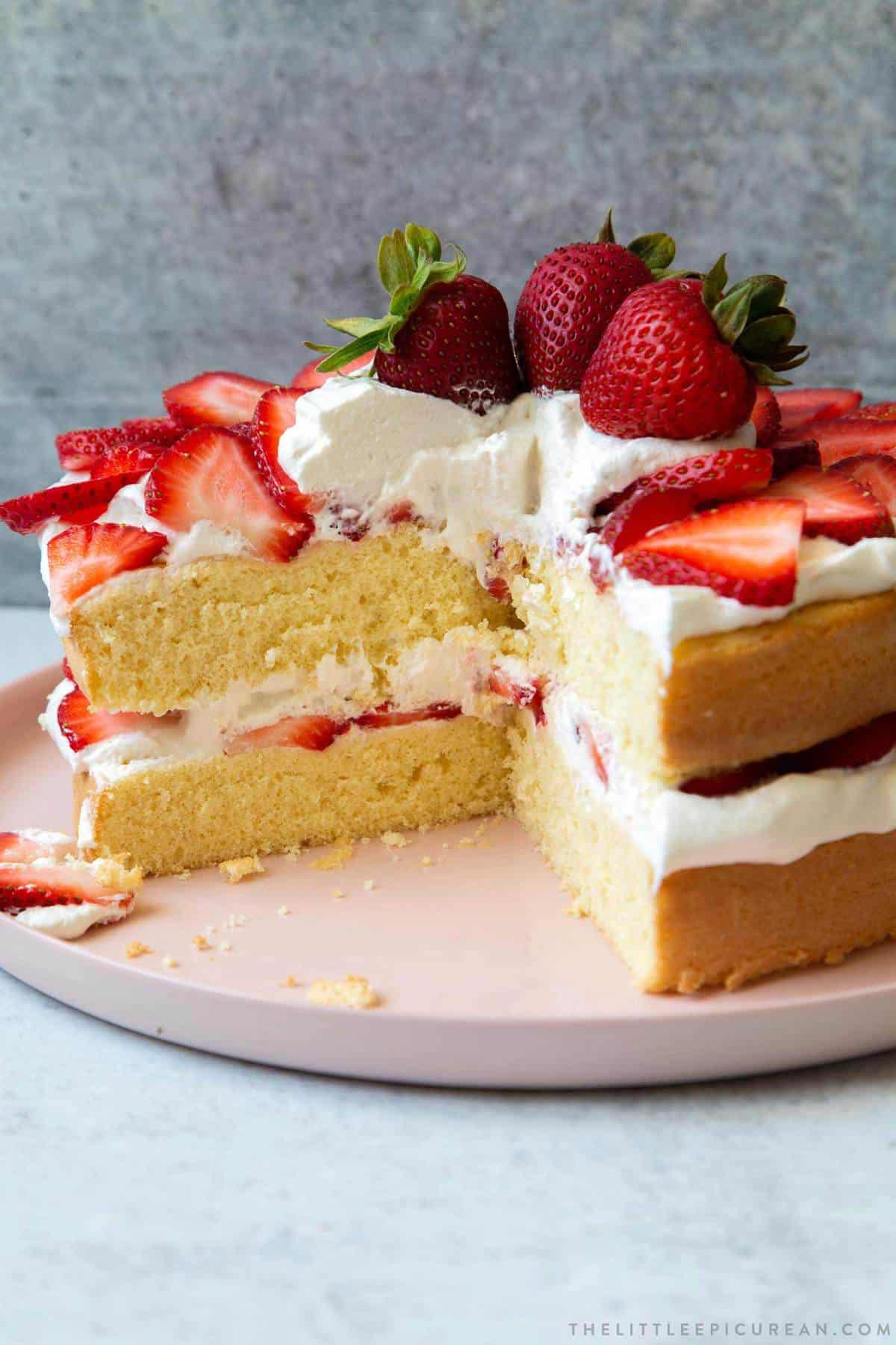 sliced strawberry sponge layer cake