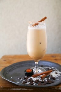 coconut coffee cocktail with cinnamon stick