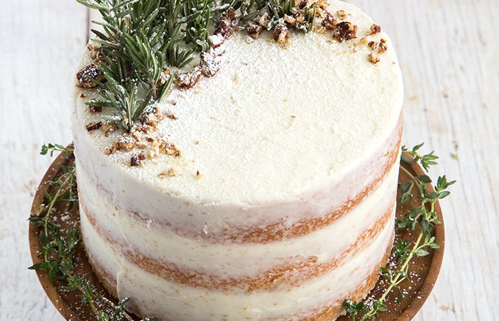 Rosemary Lemon Cake garnished with fresh rosemary