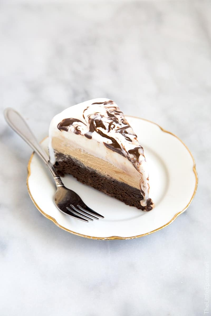 Slice of Coffee Ice Cream Cake. This coffee ice cream cake has a decadent brownie bottom topped with coffee ice cream and a layer of vanilla ice cream swirled with fudge.