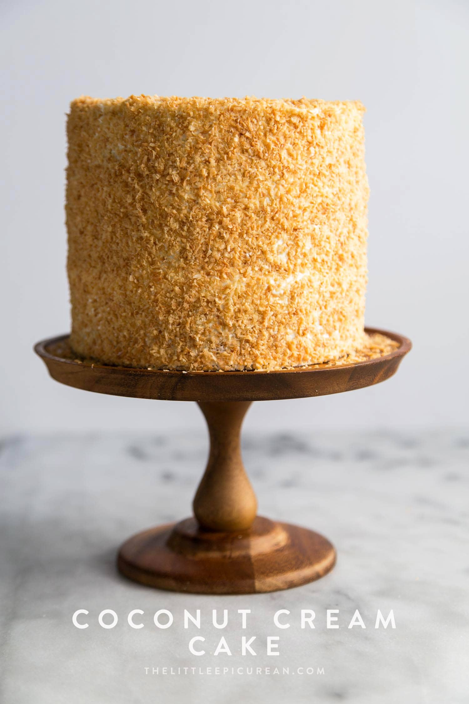 Coconut Cream Cake with toasted coconut