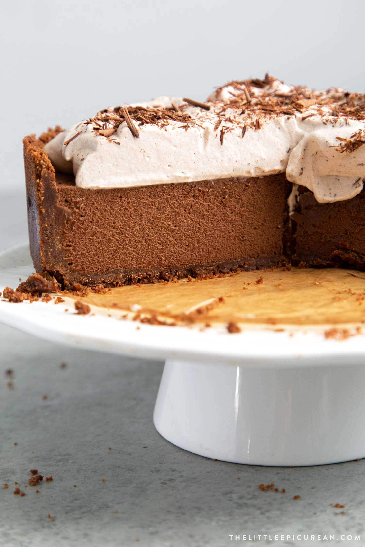 Chocolate Mousse Pie. Chocolate graham cracker crust filled with chocolate mousse and topped with whipped cream and chocolate shavings.