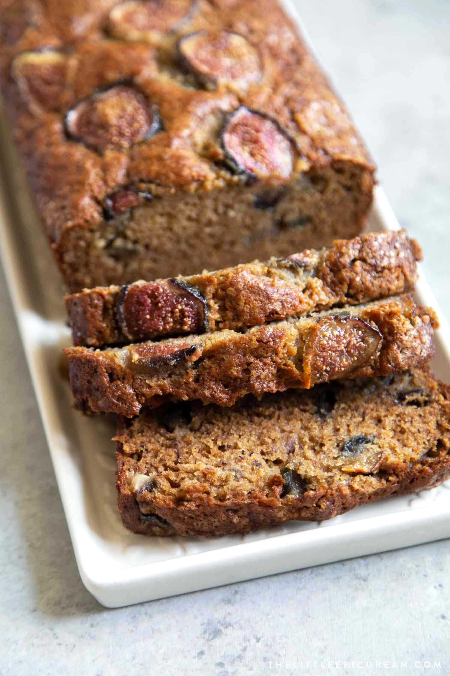 Brown sugar banana bread mixed with chopped figs in the batter and sliced figs on top to garnish.
