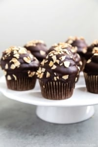 Almond Mocha Hi-Hat Cupcakes. Easy to make chocolate cupcakes topped with espresso meringue. It's dipped in chocolate and topped with toasted almonds.