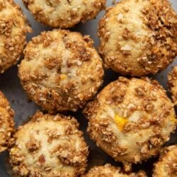 Almond Streusel Peach Muffins. Vanilla muffins mixed with fresh peaches and topped with almond streusel crumble.