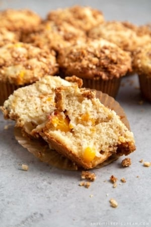 Almond Streusel Peach Muffins. Vanilla muffins mixed with fresh peaches and topped to almond streusel crumble.