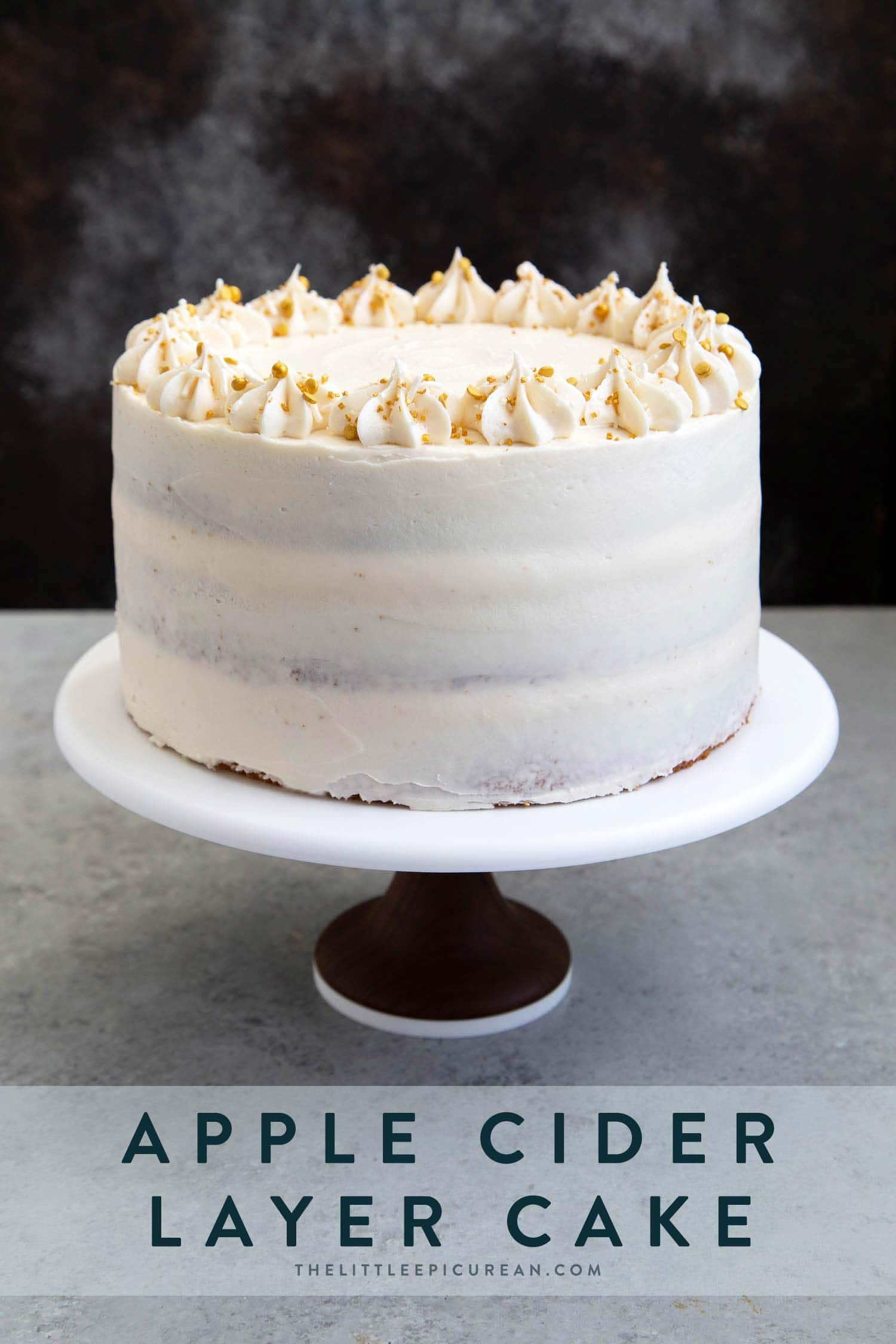 Apple Cider Layer Cake. Yellow cake flavored with apple cider. Layered cake is filled with cooked apples and frosted with apple cider buttercream.