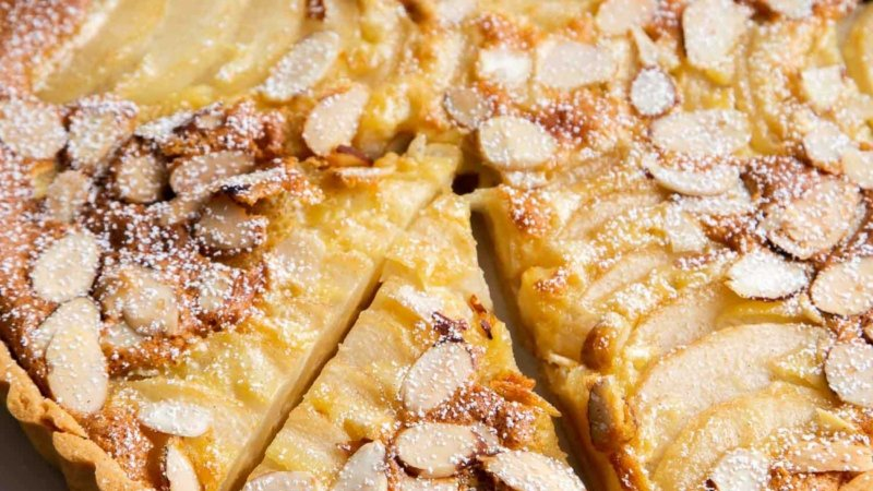 Pear Frangipane Tart. Buttery shortbread crust baked with almond frangipane filling and sliced pears.