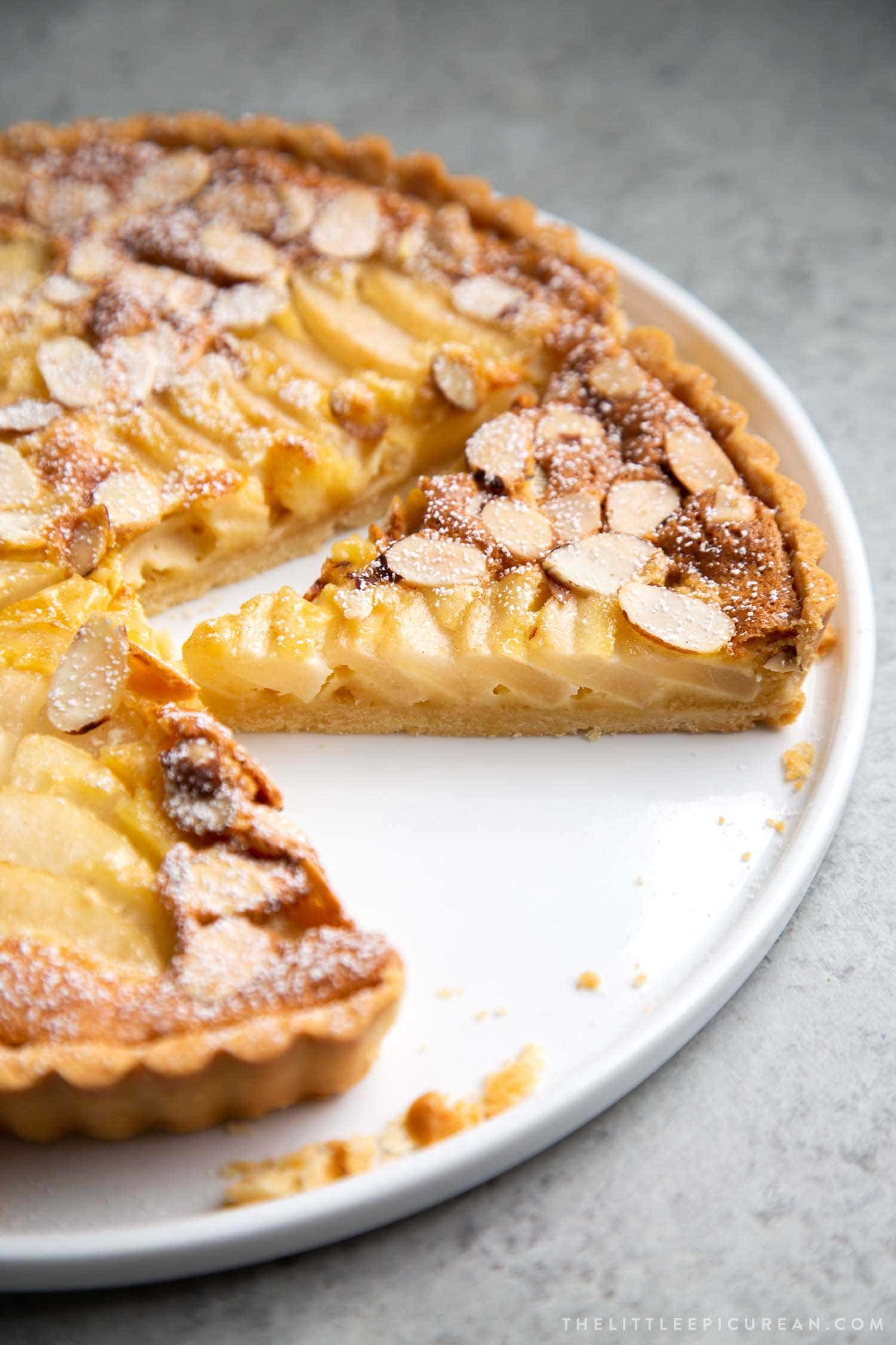 Pear Frangipane Tart Slice. Buttery shortbread crust baked with almond frangipane filling and pears.