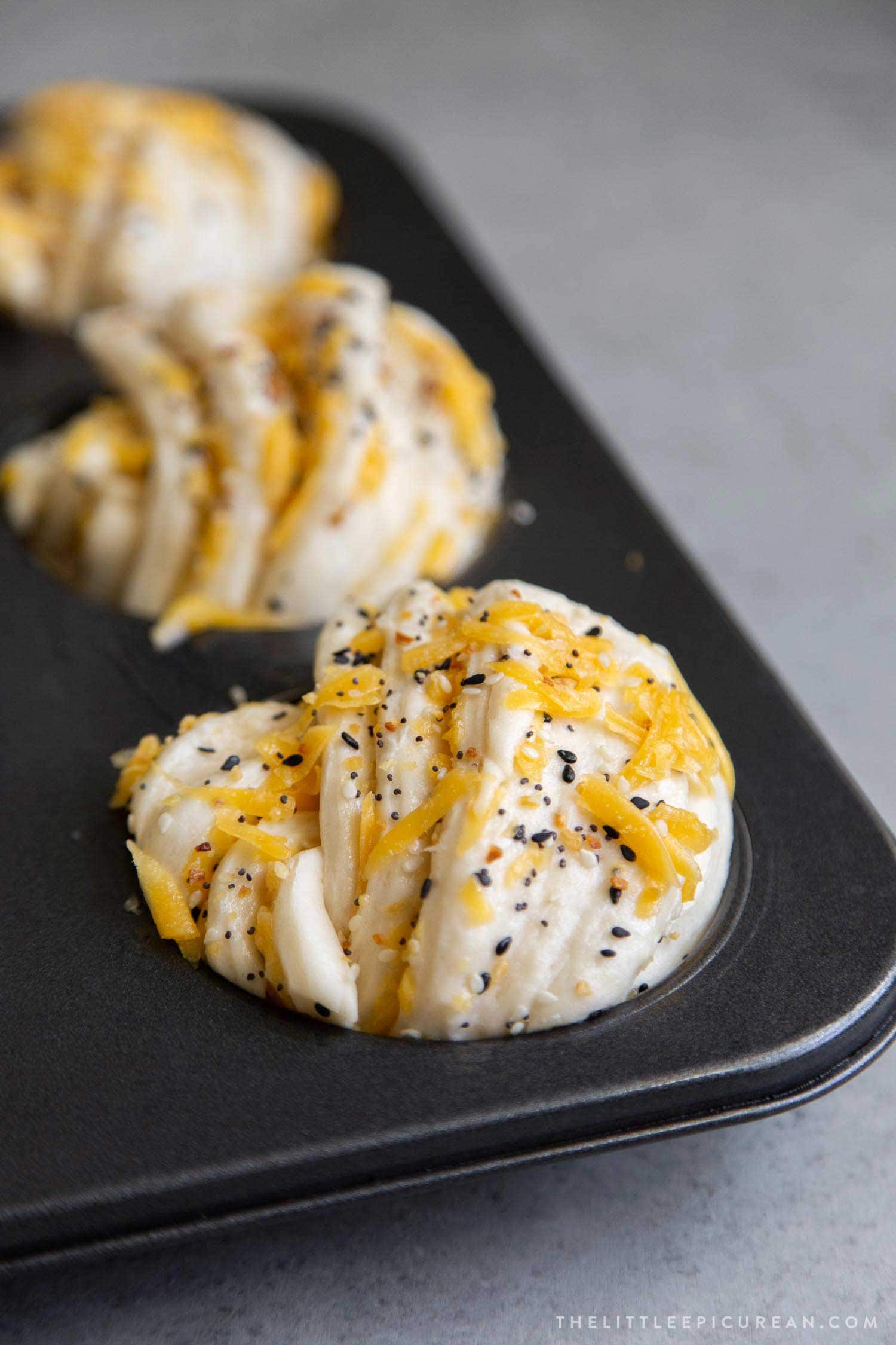 Cheddar Everything Babka Buns proofed and baked in giant muffin tins
