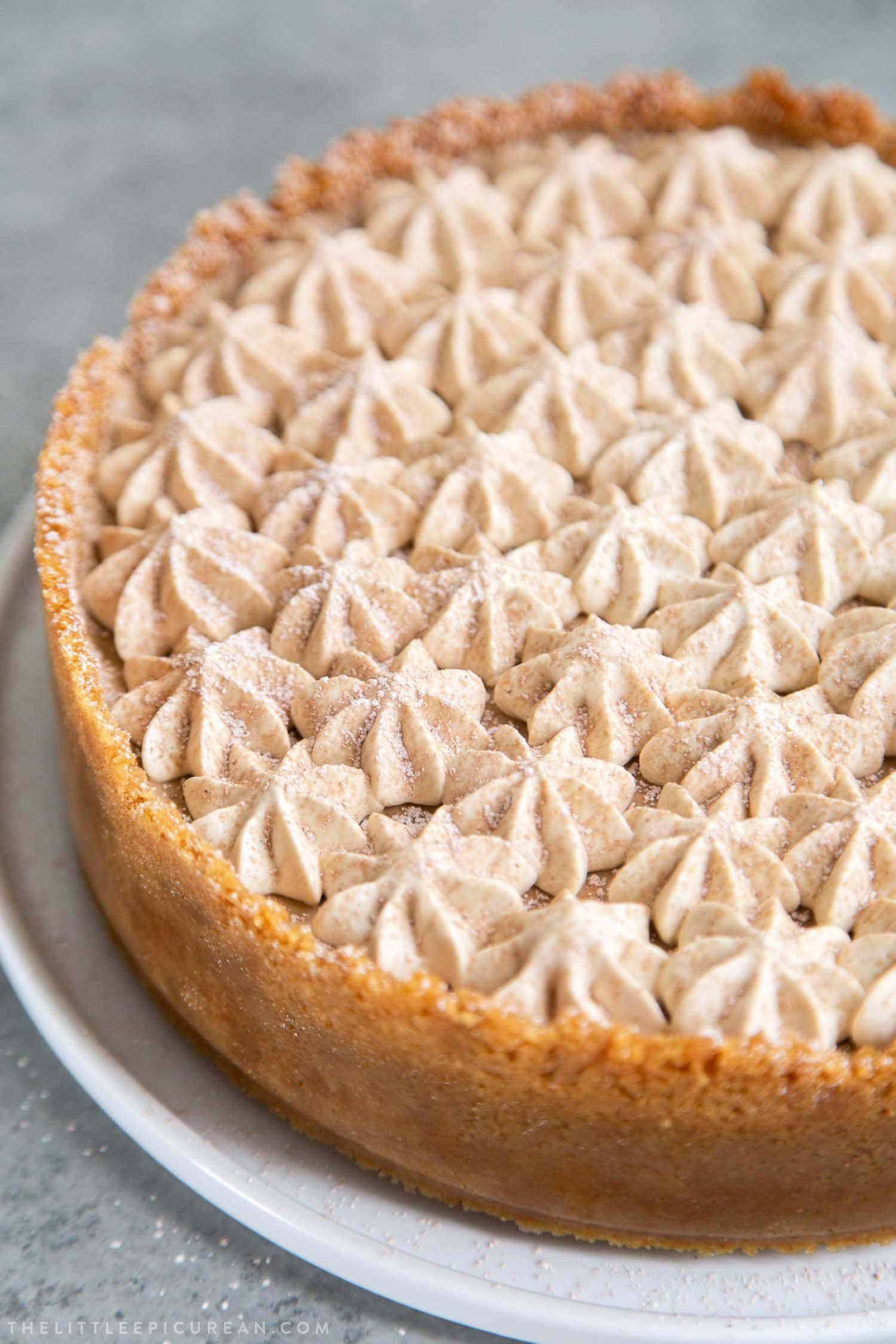 Coffee Mousse Cheesecake. Graham cracker crust, silky cheesecake layer topped with coffee mousse and whipped cream.