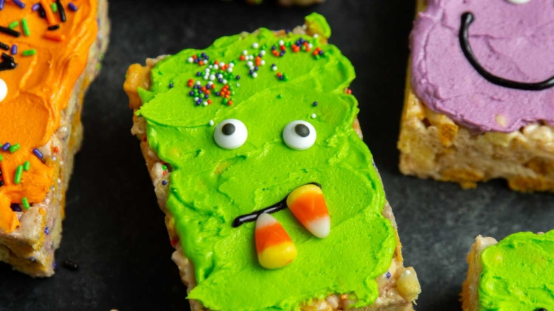 Monster Marshmallow Cereal Treats. Brown butter cereal treats frosted with buttercream and decorated with candies. It's a fun project to do with kids this Halloween!