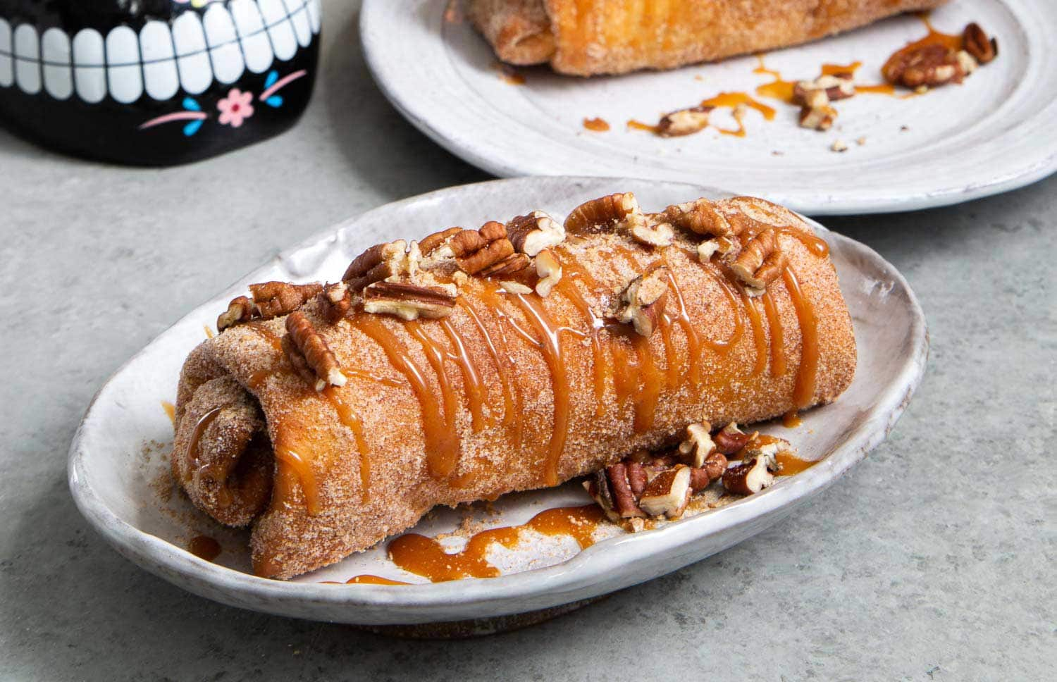Pineapple Cheesecake Chimichangas. Crispy fried burritos filled with vanilla cream cheese and cinnamon spiced pineapple chunks. The dessert chimichangas are tossed in a sweet graham cracker powder.