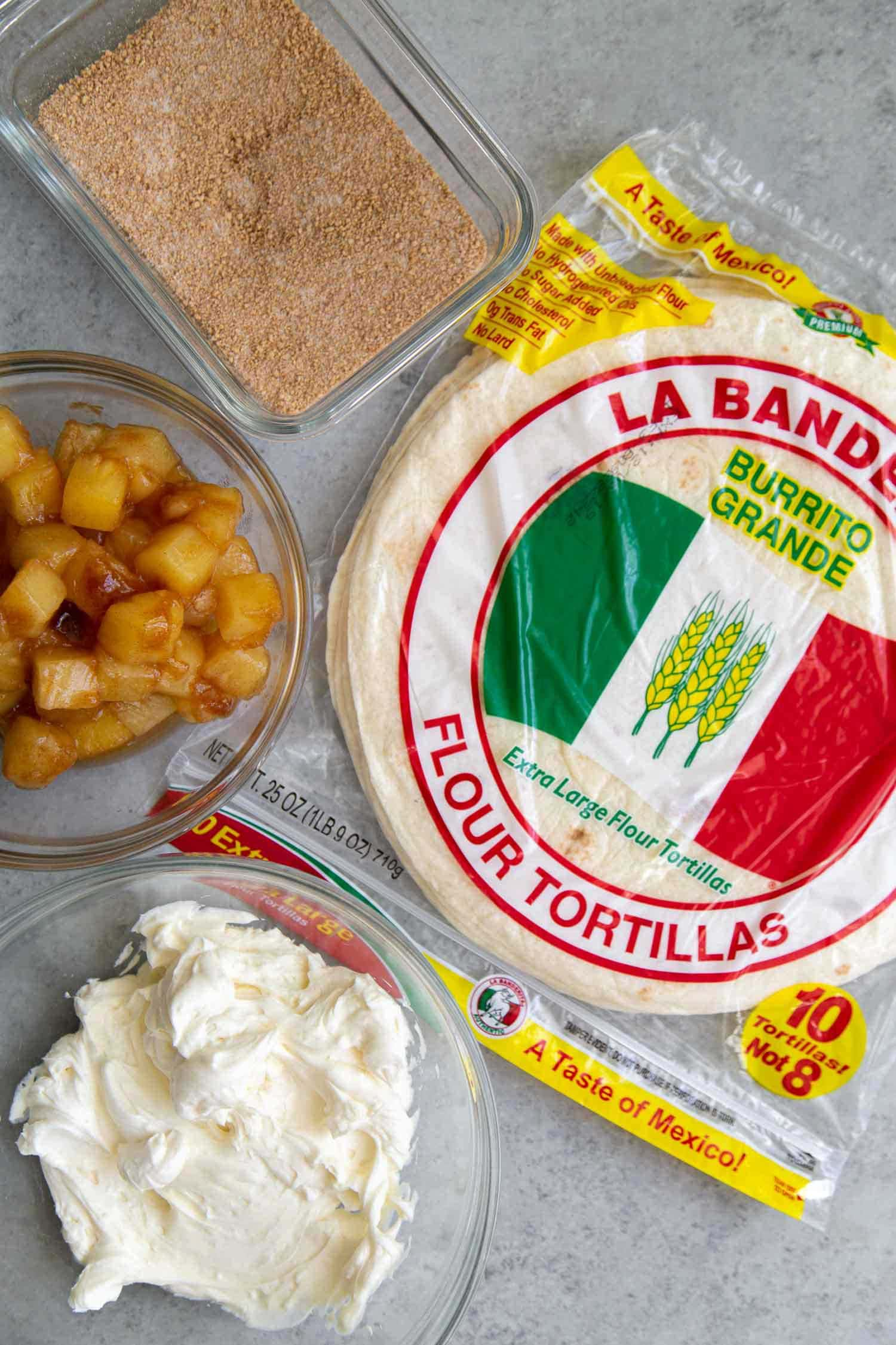 Ingredients needed for Pineapple Cheesecake Chimichangas: La Banderita 10-inch flour tortillas, vanilla cream cheese mixture, cinnamon spiced pineapples, and graham cracker crumb mixture