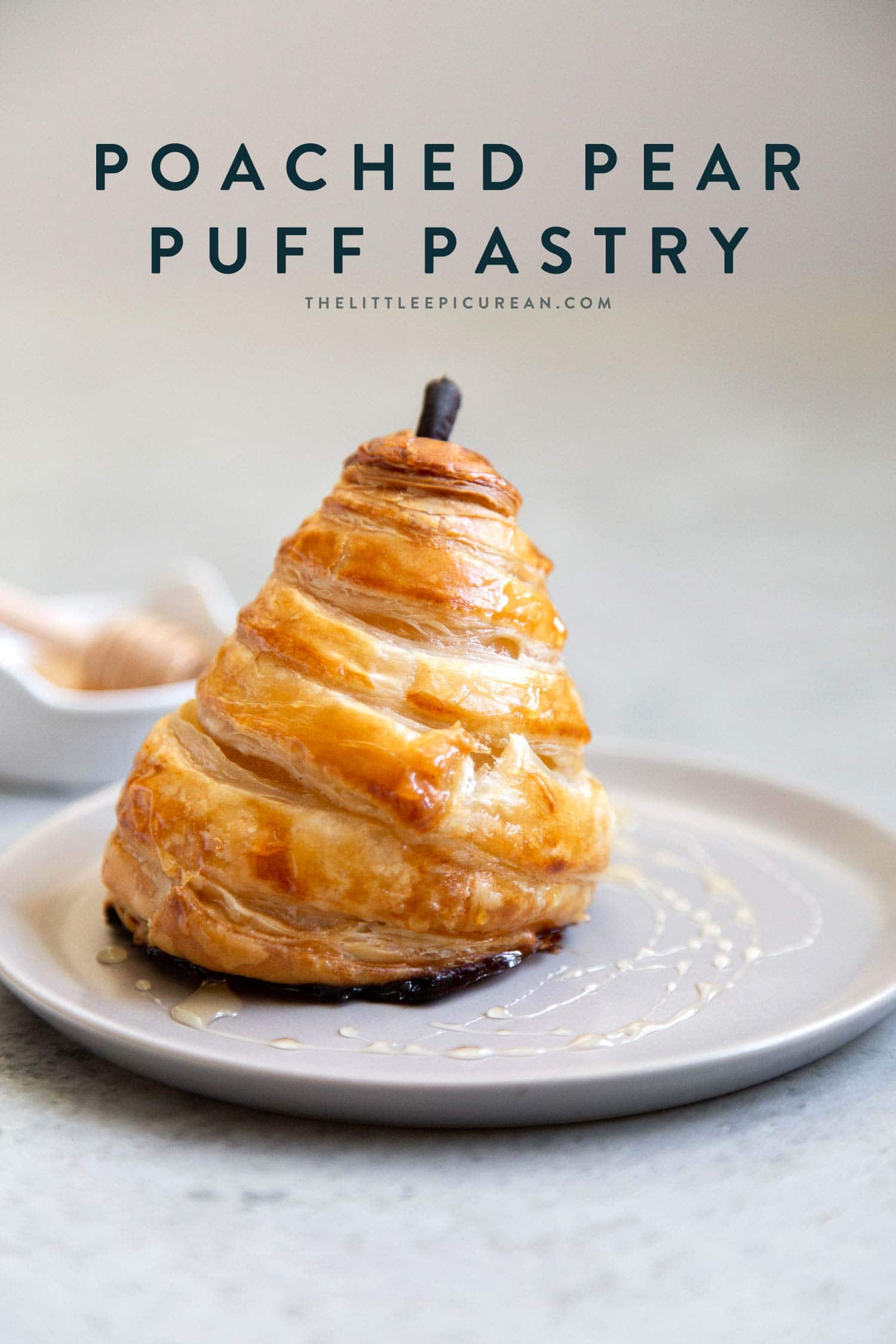 Poached Pear Puff Pastry. Pears poached in sweet vanilla cinnamon liquid. Encased in puff pastry and baked until golden. #pear #peardessert #falldessert #puffpastry