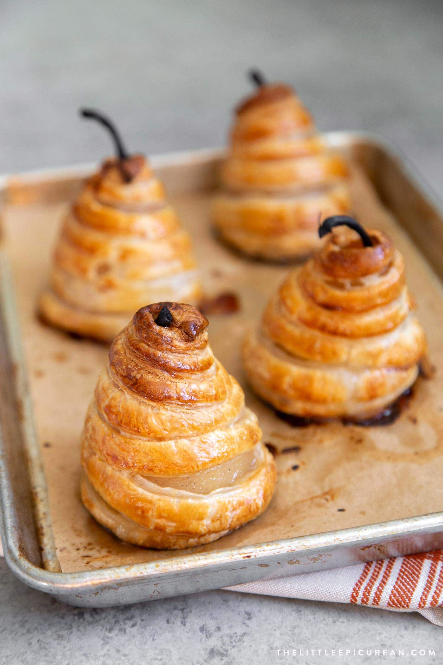 Poached pears baked in puff pastry.