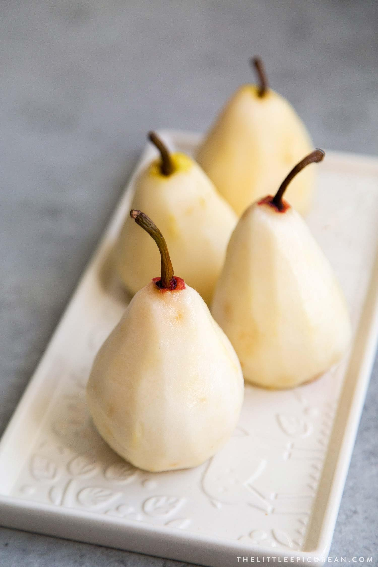 How to Poach Pears. These pears are poached in a sweet vanilla cinnamon liquid until fragrant and flavorful. They are chilled overnight before serving.