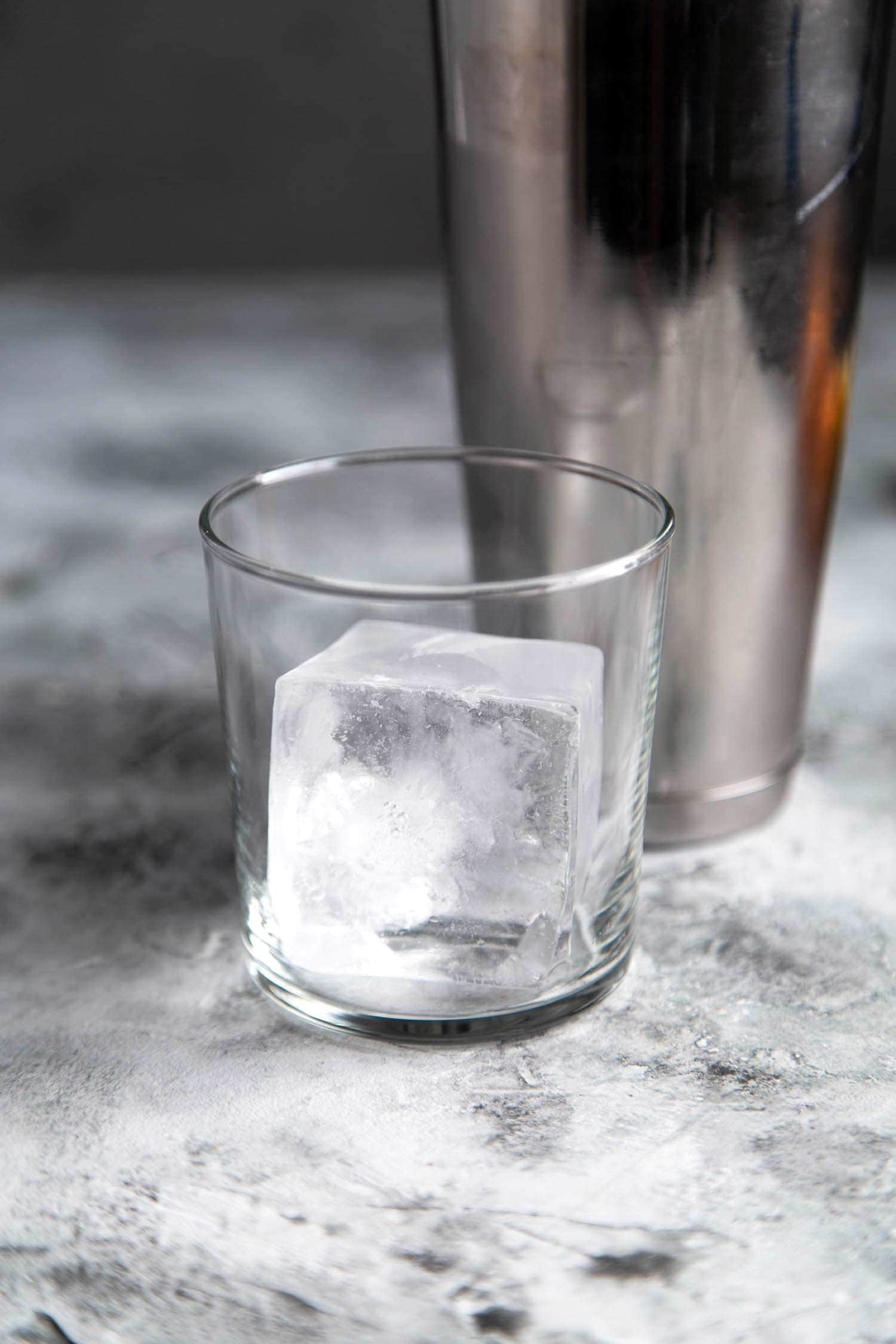 Use a large ice cube for this pumpkin bourbon cocktail (autumn harvest cocktail)