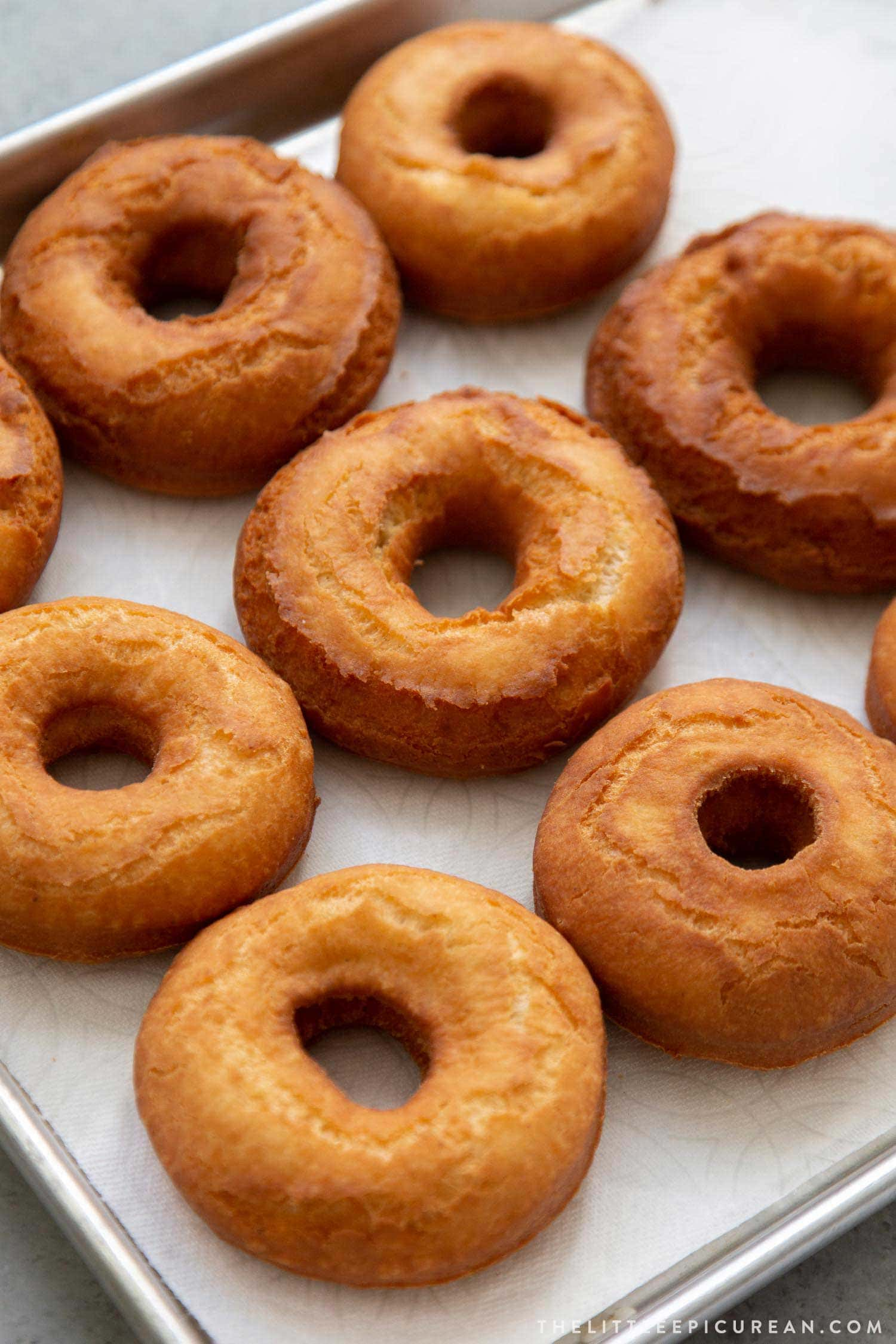 Fried old fashioned donuts before glaze.