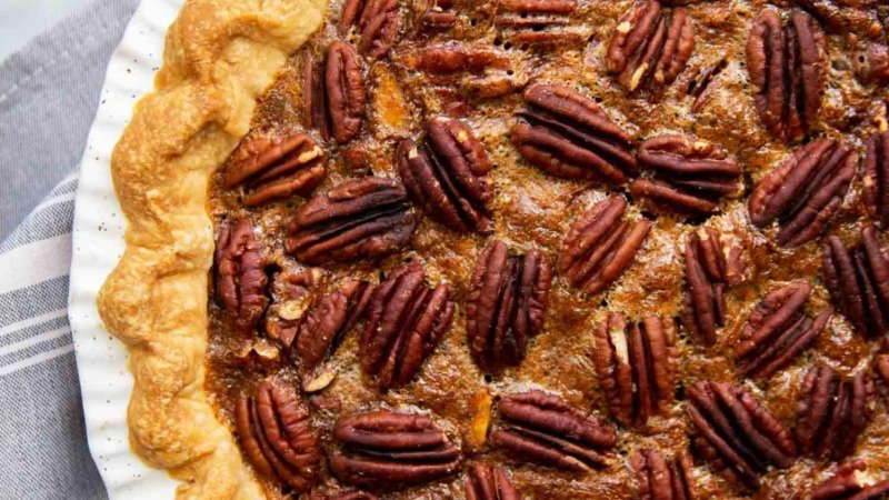 Brown Butter Pecan Pie. Traditional pecan pie with the added warmth and nuttiness of brown butter. This recipe includes a homemade butter pie crust. Perfect for Thanksgiving and beyond! #pecanpie #pie #classicpie #recipe #thanksgiving #holidays #fallbaking