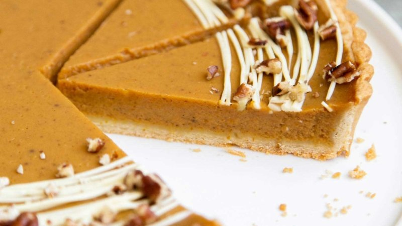 Easy Pumpkin Tart. Tart shell is made with a buttery shortbread crust. The one bowl pumpkin filling is a breeze to a make. It's decorated with melted white chocolate and chopped pecans. #pumpkin #pumpkintart #piesandtarts #dessert #thanksgiving