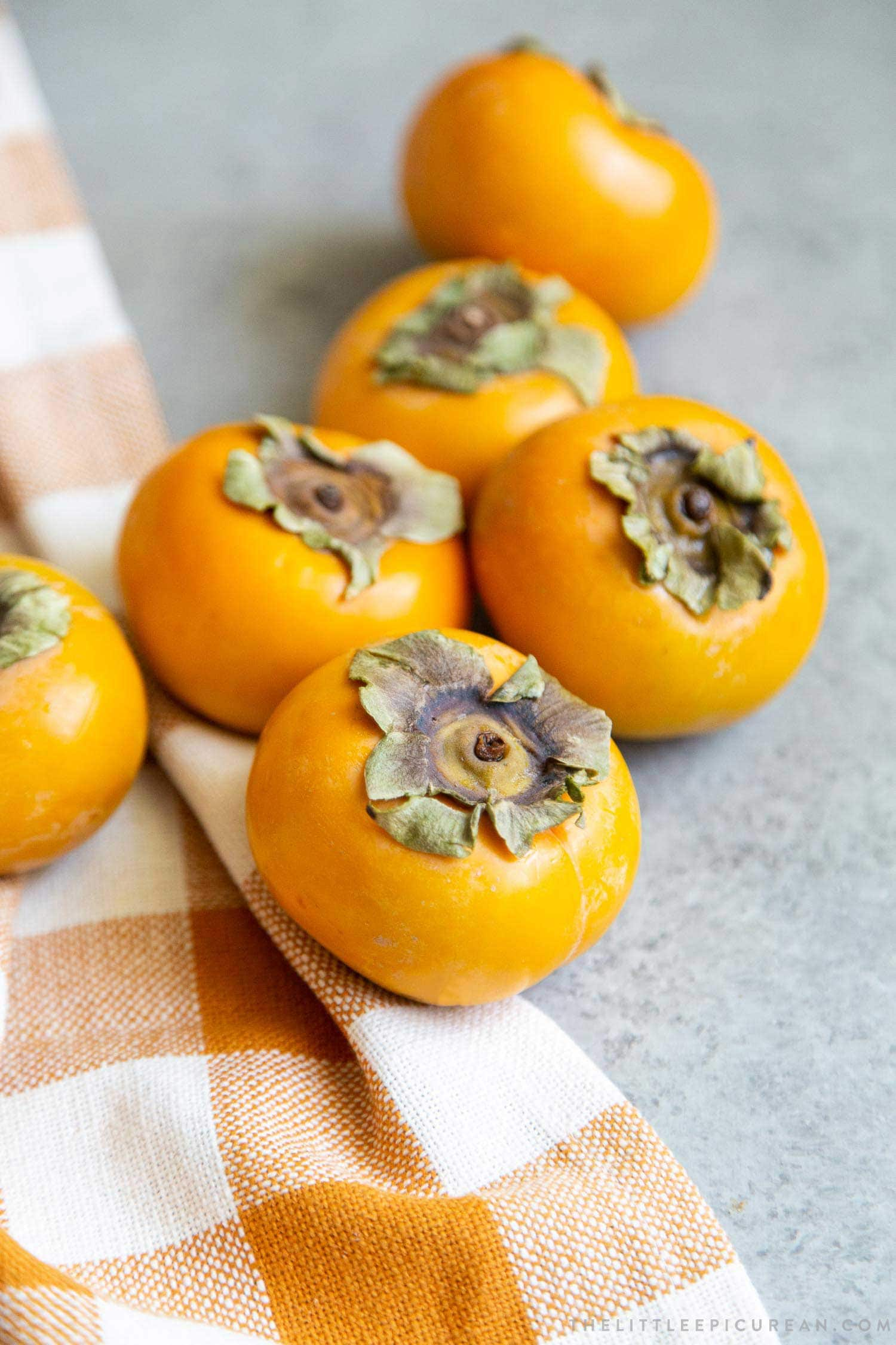 Use Fuyu Persimmons to make coconut persimmon shortcakes. Fuyu is crisp like an apple. Peel the skin and quarter it into wedges. The fuyu is best eaten while it is still firm.