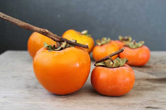 What is the difference between Hachiya and Fuyu Persimmons? Learn about these autumn fruits and how to use them in baked goods.