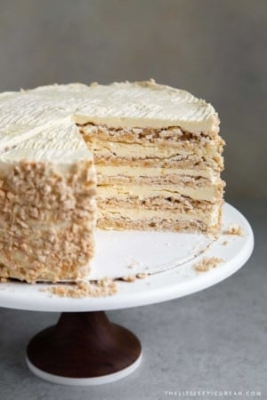 Interior shot of Sans Rival Cake. Filipino cake consisting of cashew dacquoise layered with French buttercream. #cake #dessert #glutenfree #cashews #buttercream #filipino #filipinodesserts #filipinorecipes