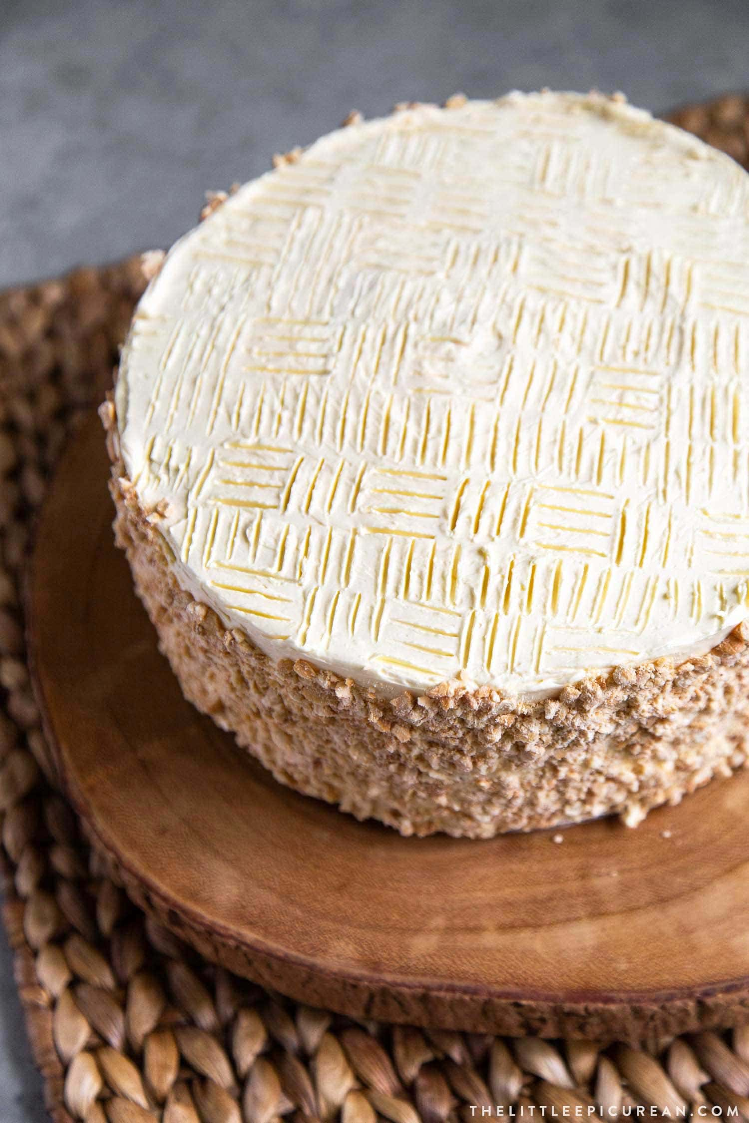 Decorate the top of Sans Rival Cake by making patterns with the tines of a fork. #sansrival #cake #filipinocake #easycakedecor #layercake #cashewcake