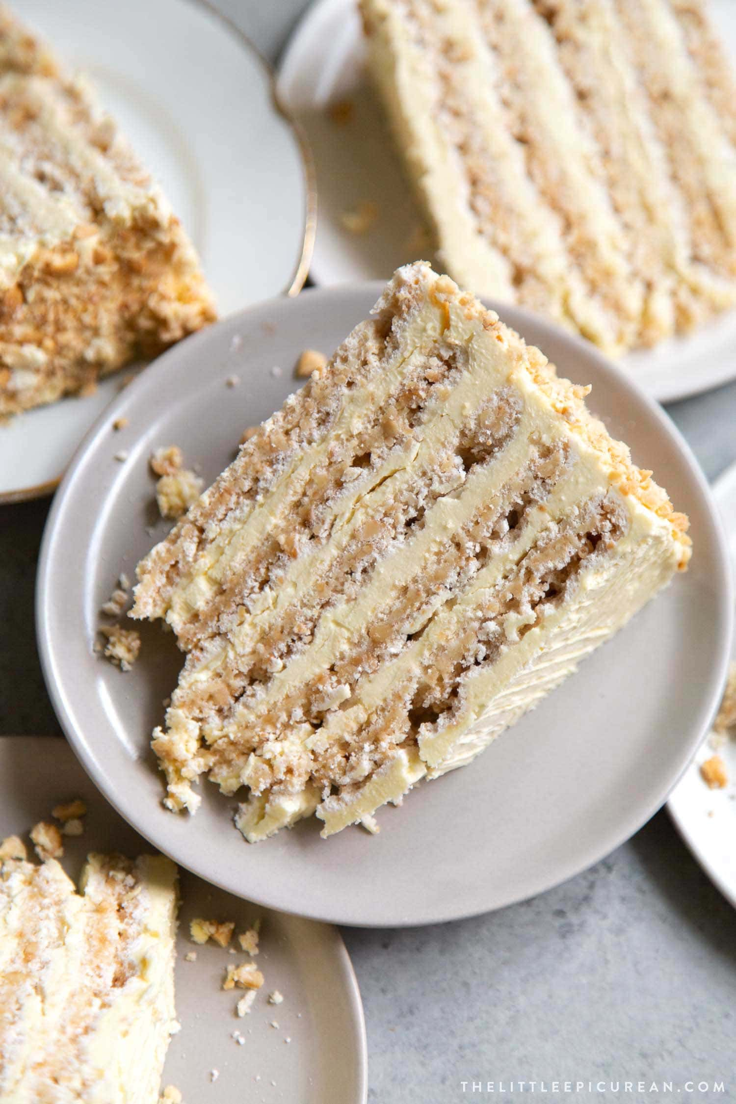 Sans Rival cake slice. Filipino cake consisting of cashew dacquoise layered with French buttercream. #cake #dessert #glutenfree #cashews #buttercream #filipino #filipinodesserts #filipinorecipes