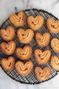 Cinnamon Sugar Palmier. These crispy mini cookies are made with puff pastry. They're super easy to assemble! #palmier #cookies #cinnamonsugar #easyrecipe #dessert