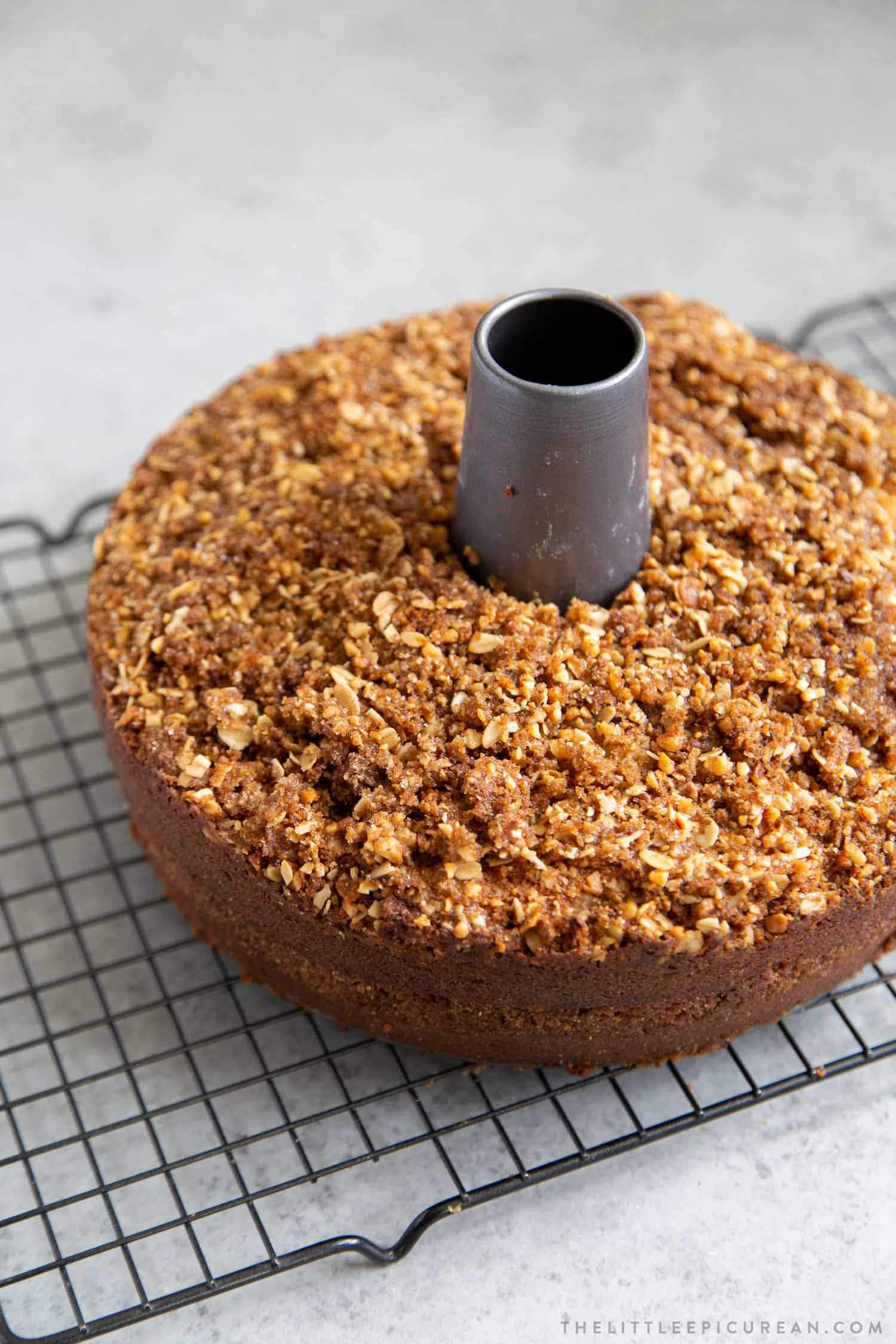 Banana Crumb Cake. Moist banana cake with cinnamon sugar filling topped with walnut oat crumble topping.