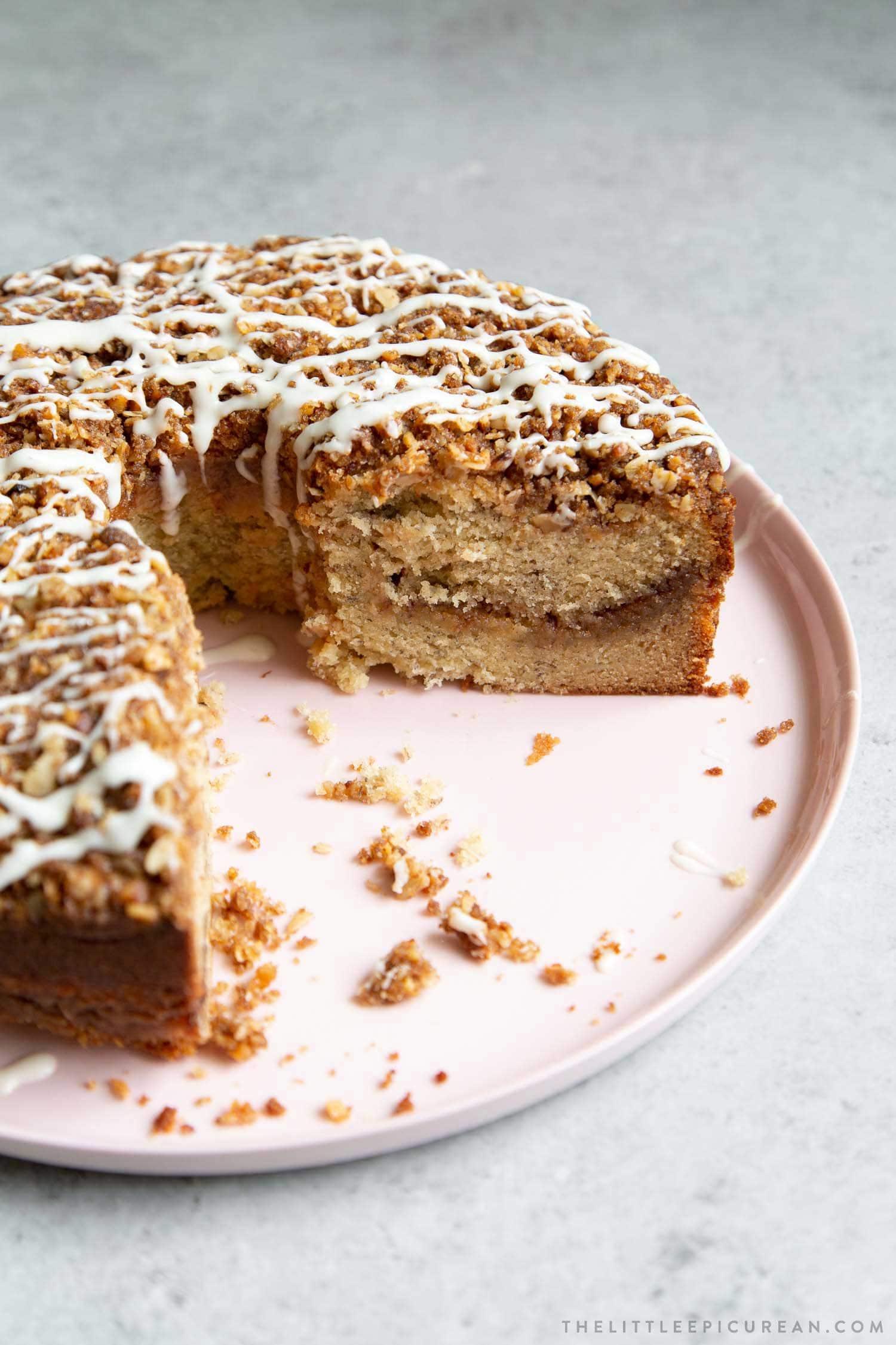 Banana Crumb Cake. Moist banana cake with cinnamon sugar filling topped with walnut oat crumble topping. Banana Crumb Cake. Moist banana cake with cinnamon sugar filling topped with walnut oat crumble topping. Finished with maple glaze icing.