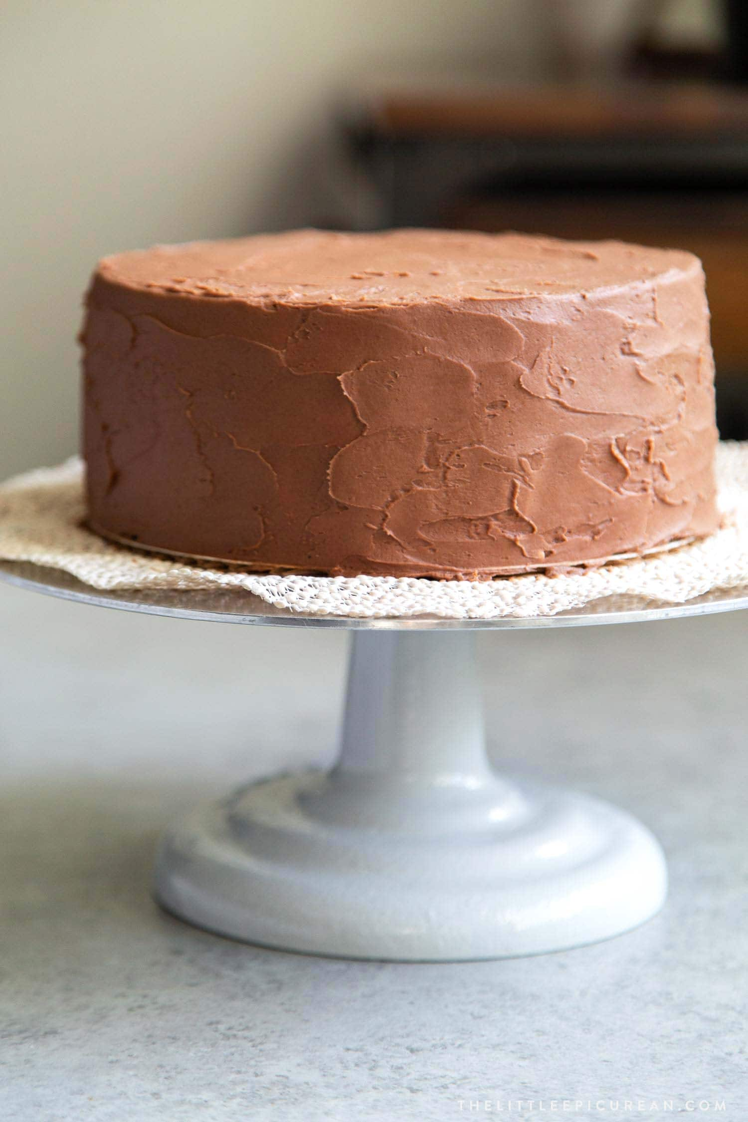 Two layer 8-inch Classic Chocolate Cake with Simple Chocolate American Buttercream.