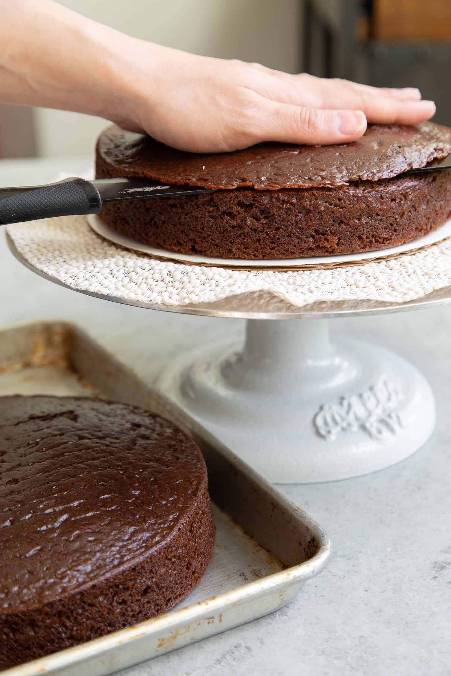 This classic chocolate cake recipe makes two 8-inch cake layers or three 6-inch cake layers. Use a serrated cake knife to level cake layers if necessary.