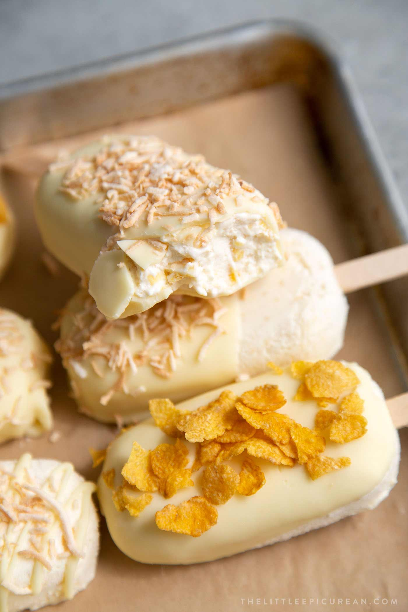White chocolate dipped corn ice cream topped with corn flakes and shredded coconut