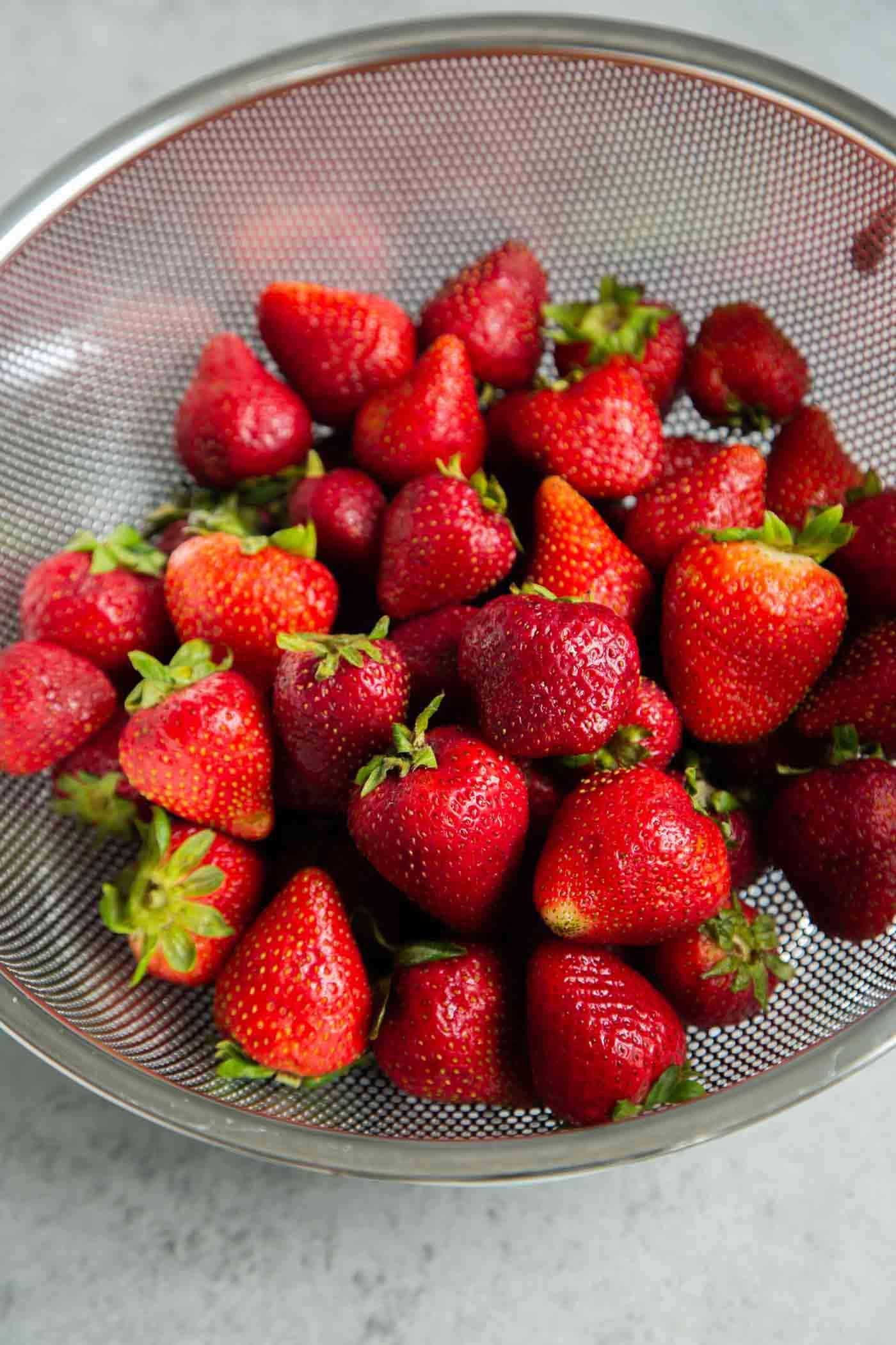 Clean strawberries before freezing