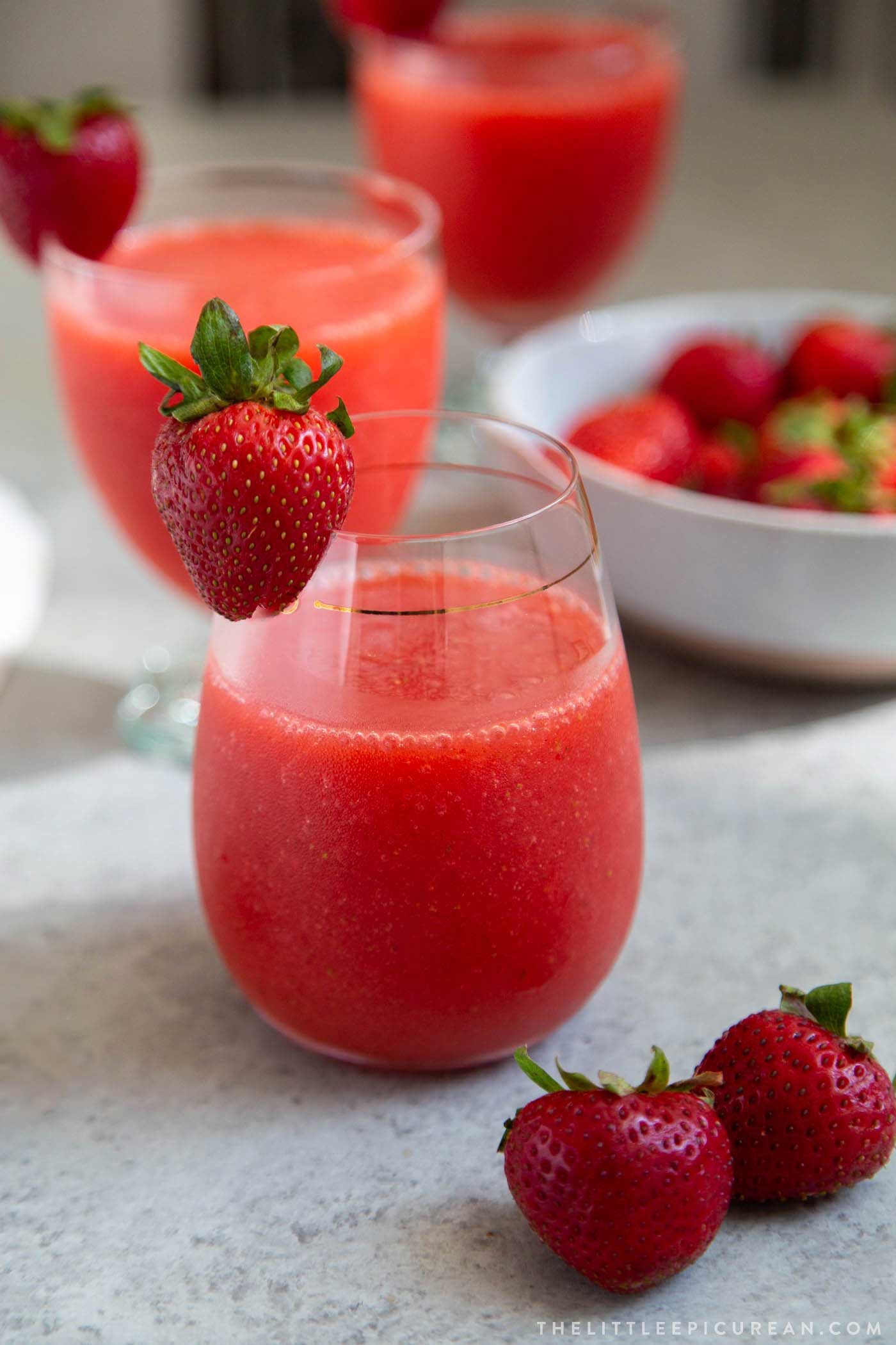 Frozen strawberry daiquiri made with frozen strawberries, light rum, lime juice, and simple syrup