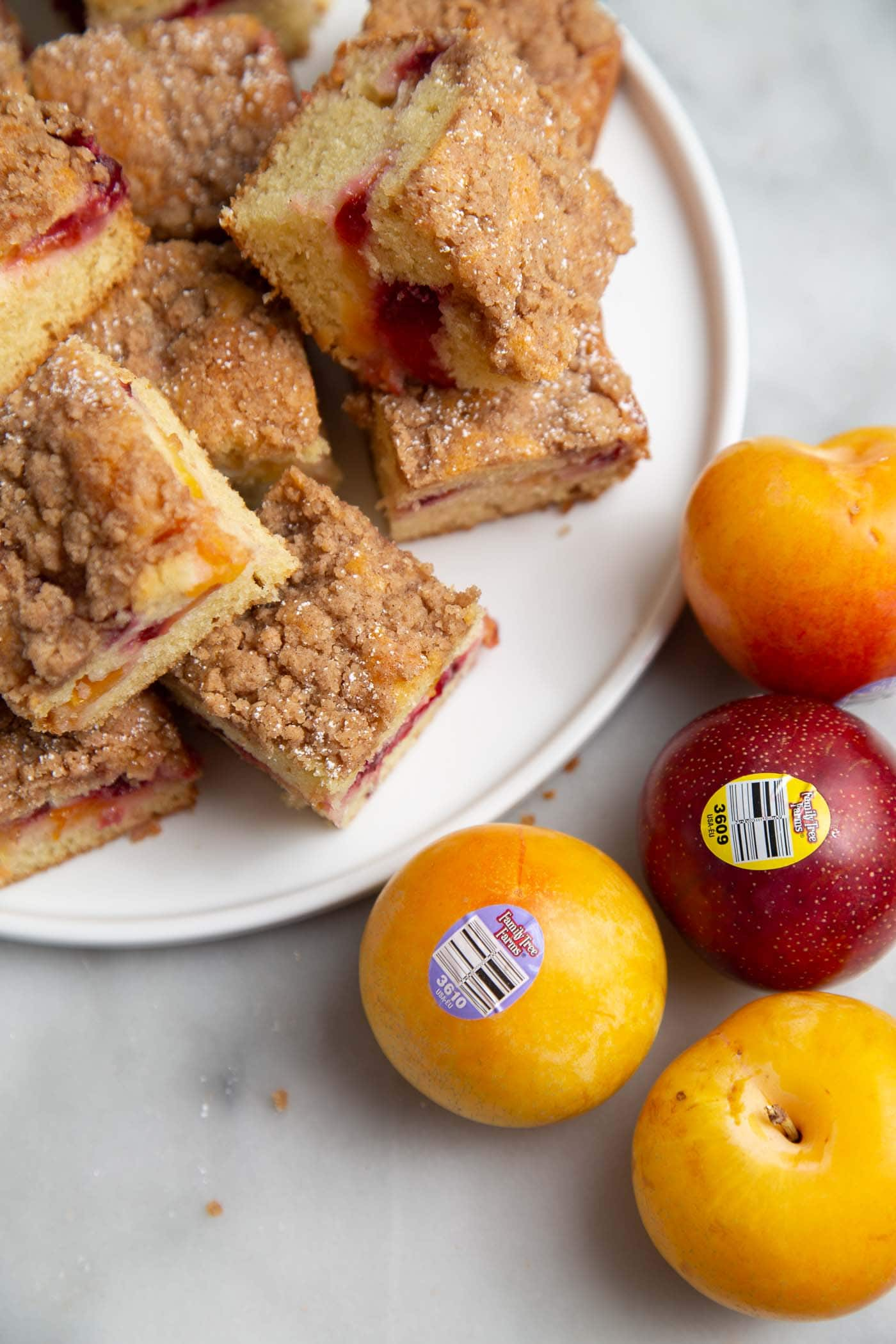 Plumcot Crumb Cake featuring vanilla cake with sliced plumcots and spiced crumble topping