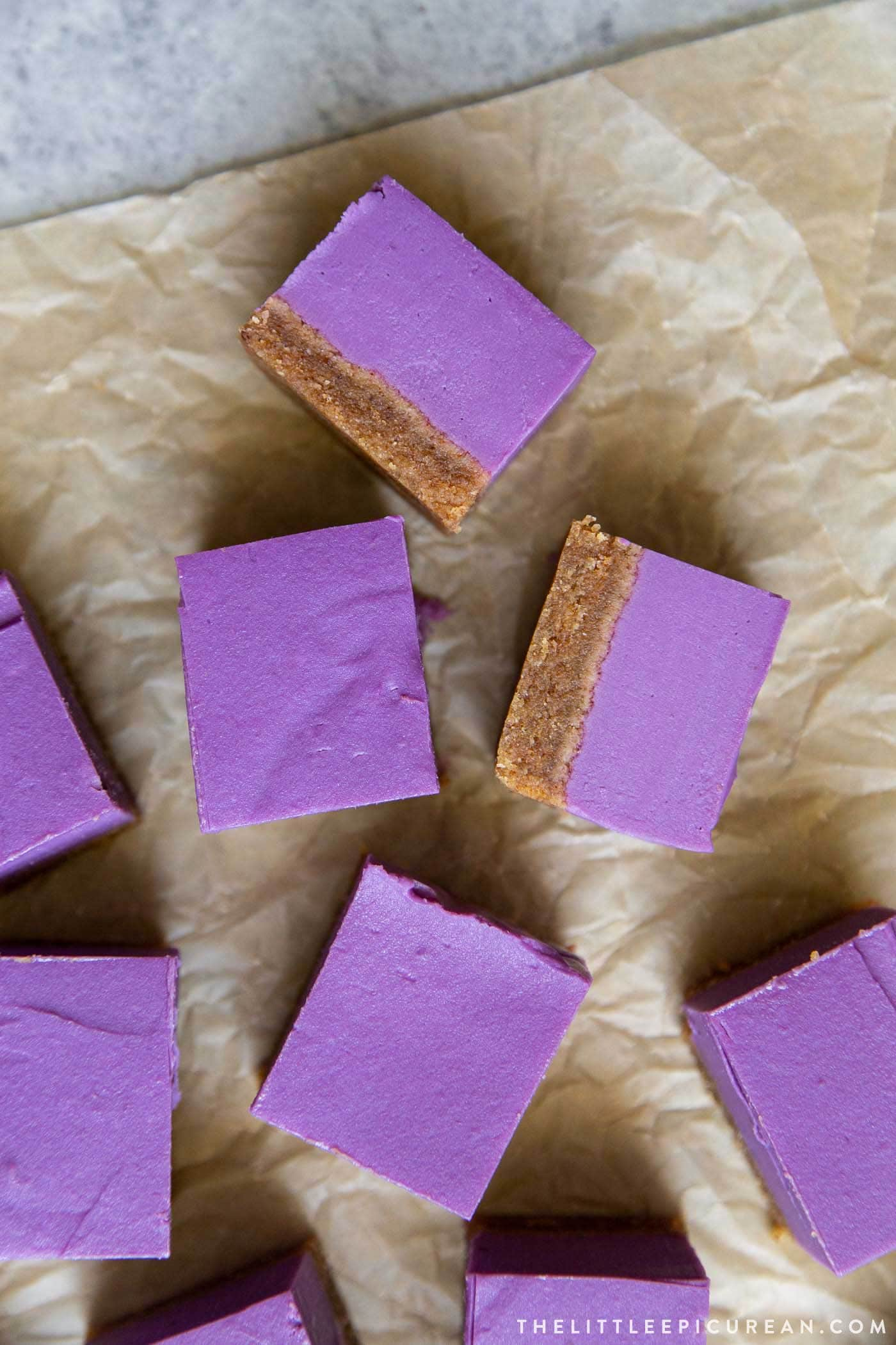 Purple sweet potato pie bars with almond butter crust. This all-natural dye-free vegan treat is great any season.