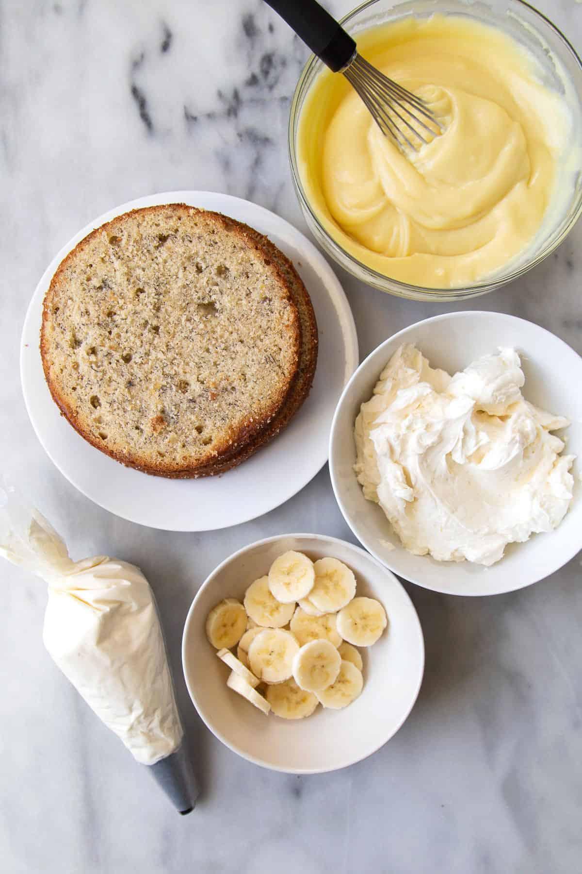 Banana Cream Cake components include pastry cream, sliced bananas, and banana cake layers